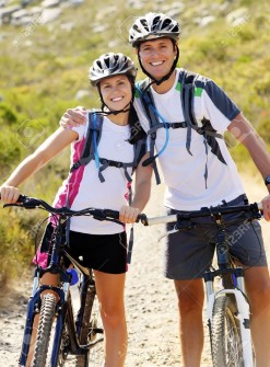 12347213-Happy-carefree-mountain-bike-couple-cycling-outdoors-and-leading-a-healthy-lifestyle--Stock-Photo